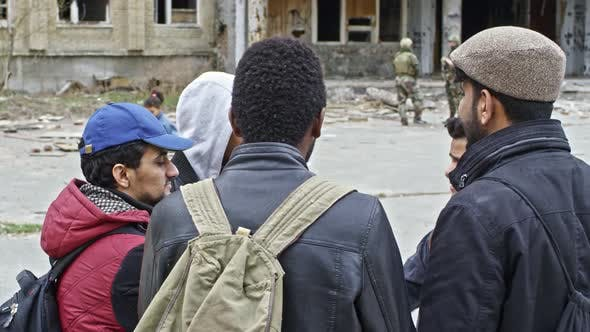 Thumbnail for Homeless Refugees Talking before Destroyed Building