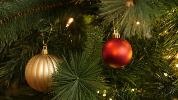 Luxurious Christmas tree ornaments close-up 4K 2160p 30fps UltraHD footage - Gold and red baubles wi