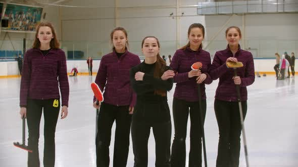 Thumbnail for Curling Training - the Judge Standing on the Ice Rink with Her Women Students - the Judge Crossing