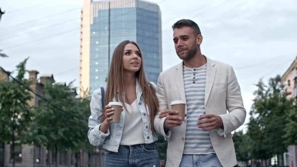 Thumbnail for Young Couple Walking with Coffee on Date