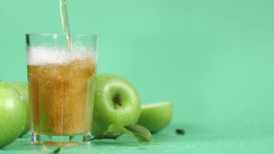 Pour Fresh Apple Juice Into a Glass