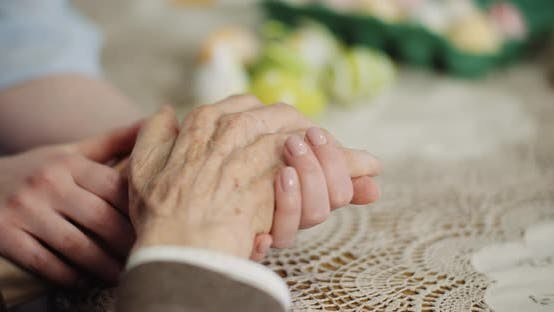 Thumbnail for Woman Comforting Wrinkled Old Hand