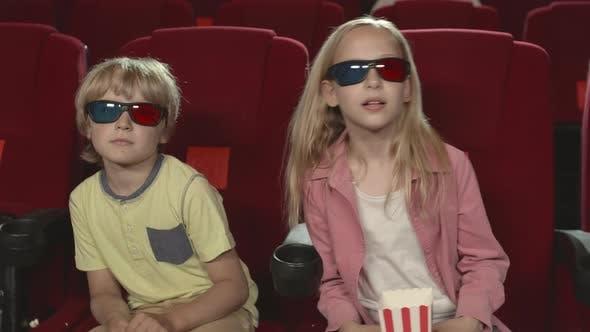 Two Kids Watching 3d Movie in Cinema