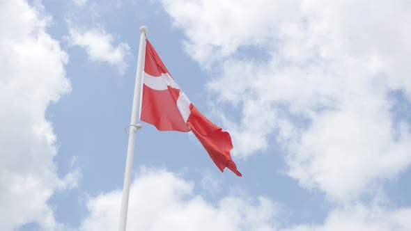 Thumbnail for Famous Denmark national flag in front of cloudy sky waving 4K 2160p 30fps UHD footage - Red and whit