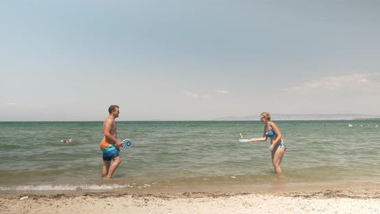 Thumbnail for Young People Enjoying Tennis in the Sea