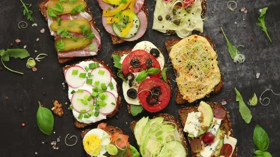 Thumbnail for Top View of Different Decorated Sandwiches As Appetizer. Healthy Food. Vegetable Meal