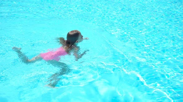 Thumbnail for Adorable Little Girl Swimming at Outdoor Swimming Pool