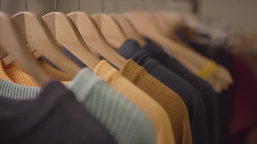 Colorful Jumpers on Hangers