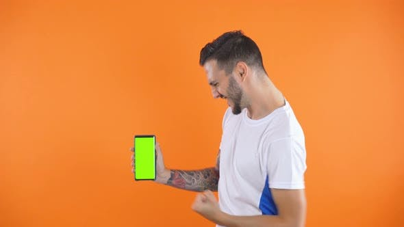 Thumbnail for Football Fan with Green Screen Phone Victory, Happy and Goal Scream Emotions of Football Fan in Game