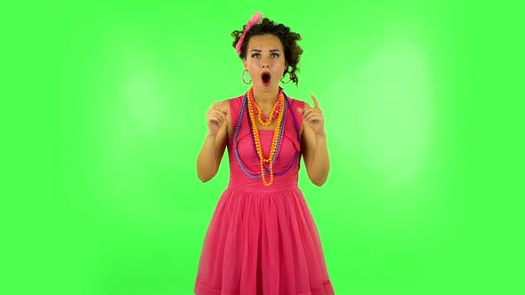 Thumbnail for Trendy Girl Poses for Camera Makes Funny Faces on Green Screen at Studio.