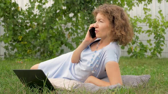 Thumbnail for Lady with notebook working outdoor. Office outdoor. Working on fresh air. Phone talking concept