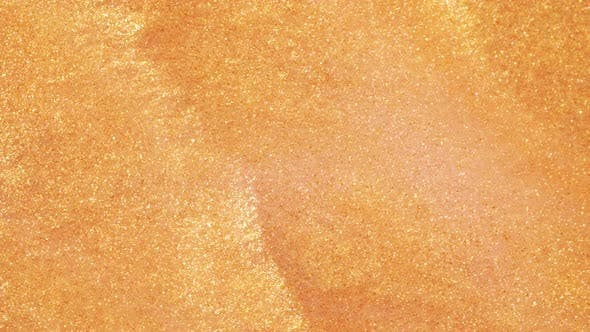 Thumbnail for Colorful Golden Sand Organically Moves in Colorful Liquid in Macro