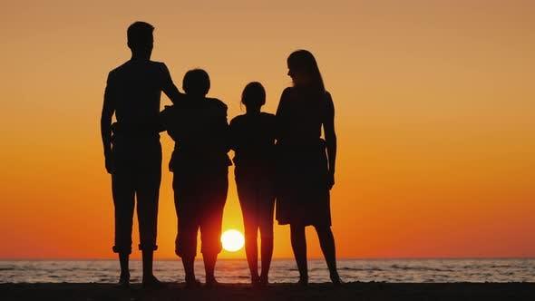 Thumbnail for Happy Multi-generational Family Enjoying Sunset Over the Sea
