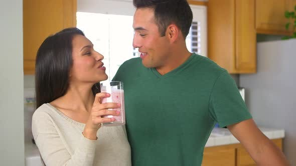 Thumbnail for Cute Mexican couple sharing a smoothie