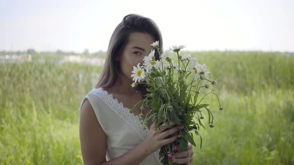 Thumbnail for Portrait Glamorous Young Girl with Brunette Hair Wearing a Long White Summer Fashion Dress Standing