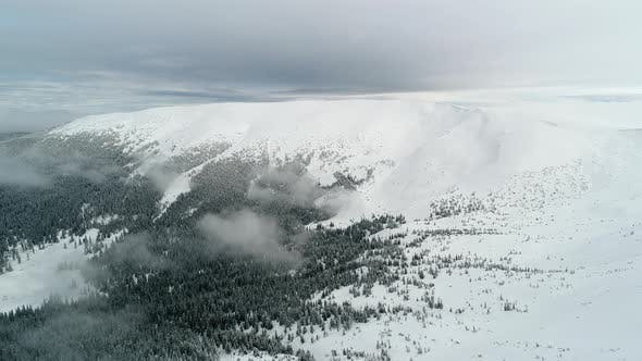 Aerial View in Foggy Winter Mountain. Environment, Nature.