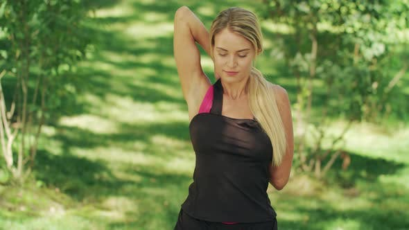 Thumbnail for Sport Woman Doing Stretch Exercise for Arms Before Training in Summer Park