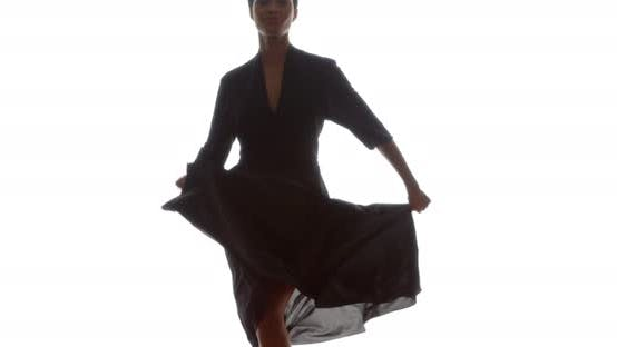 Thumbnail for Woman in black dress doing fun dance in slow motion