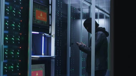 Cover Image for Black Man Hacking Computer System in Server Room