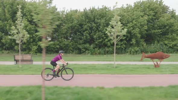 Thumbnail for Female triathlete is pedaling on cycle. Cycling and triathlon concept