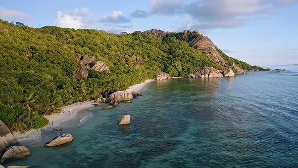 Thumbnail for Aerial Footage of Famous Tropical Beach Anse Source d'Argent at Sunset Evening Light. La Digue