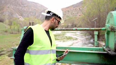 Engineer Investigates in Electric Water Dam