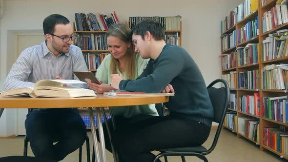 Thumbnail for Teacher with Group of Students Working on Digital Tablet in Library