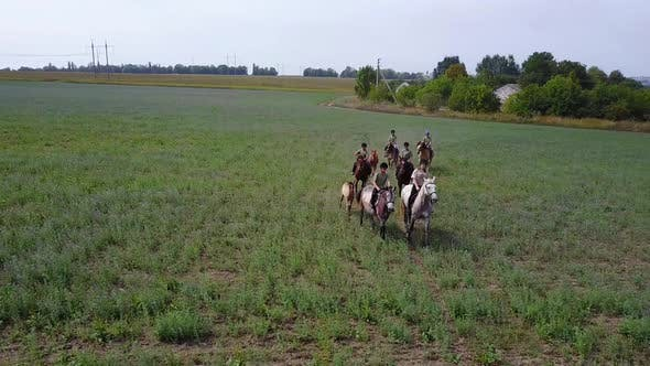 Group Of Horseback Riders. Group of young horseback riders riding in countryside