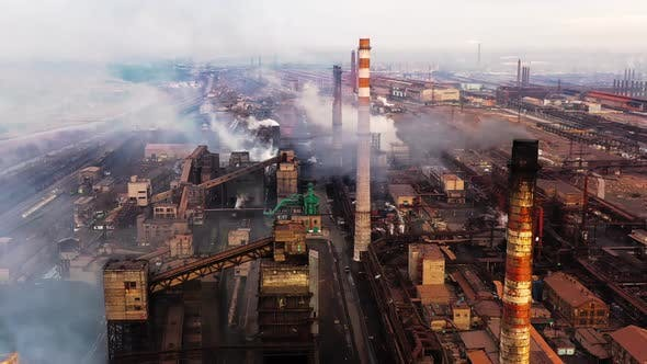 Thumbnail for Aerial. GLOBAL WARMING. View of High Chimney Pipes with Grey Smoke. Pipes Pollute Industry