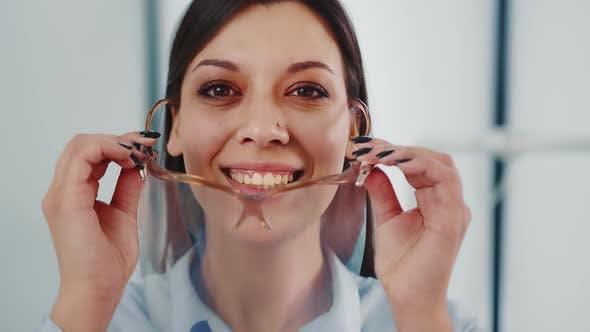 Close Up of Face of Female Dentist in Private Clinic