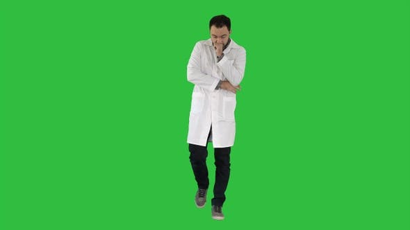 Cover Image for Tired doctor walking on a Green Screen, Chroma Key.