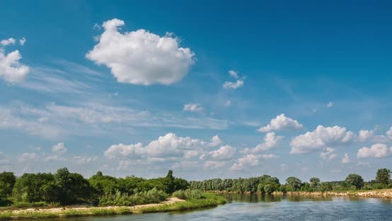 Thumbnail for River Among Green Bushes and Trees with Clouds Above It