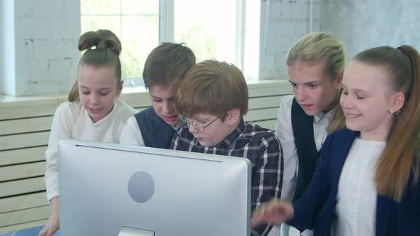 Thumbnail for Business Children Team Working Together on Laptop in Office