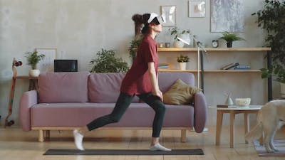 Woman in VR Glasses Having Home Workout