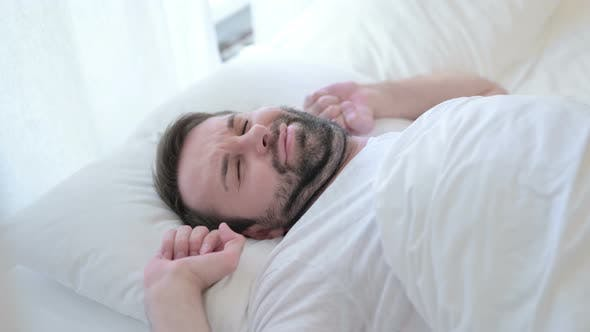 Thumbnail for Attractive Beard Young Man Waking Up and Getting Out of Bed