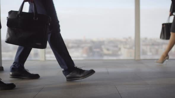 Thumbnail for Slowmo of Legs of Businesspeople Walking