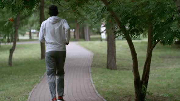 Thumbnail for Rear View of Man Having Run Workout in Park
