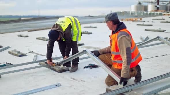 Thumbnail for Solar metal platform installation. Team of technicians installing metal platform