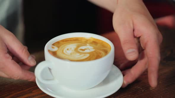 Thumbnail for Barista Makes a Drawing on Coffee