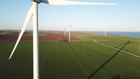 Wind power station on the field. Aerial view from drone
