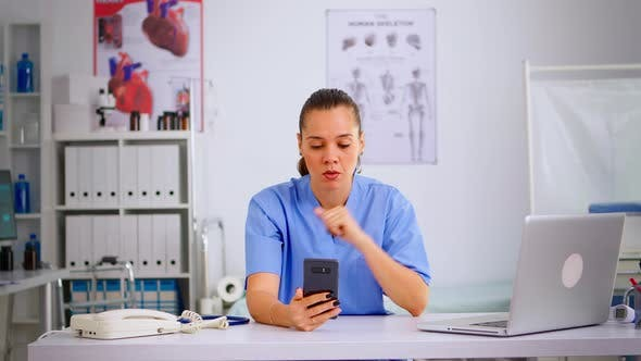 Thumbnail for Experienced Woman Nurse Giving Online Medical Consultation
