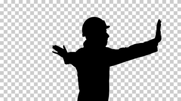 Silhouette Young workman with helmet in white robe enjoy