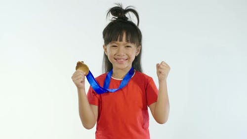 Little Girl Celebrating With Golden Medal