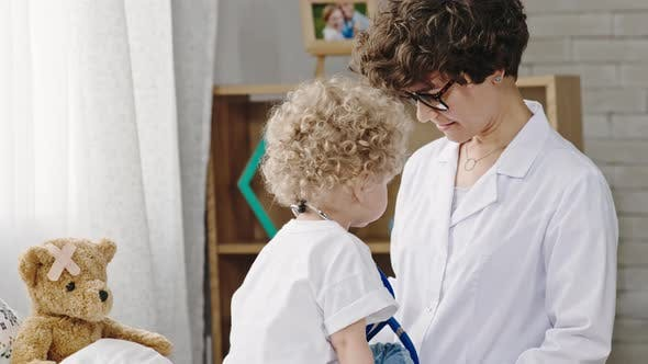 Cover Image for Toddler Pretending to be Doctor with Mother