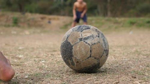 Rural Boys Playing Soccer