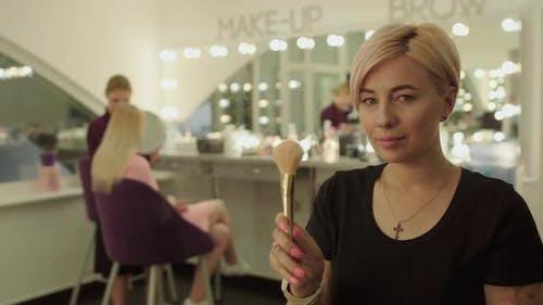 Beautiful Make-up Artist in Beauty Salon