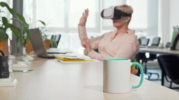 Thumbnail for Female Entrepreneur Using 3d Virtual Reality Goggles at the Office