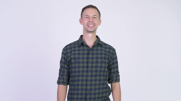 Thumbnail for Studio Shot of Happy Hipster Man Smiling While Thinking