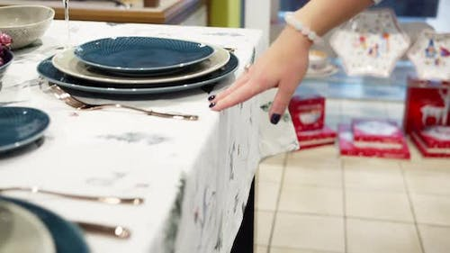 Woman's Hand Slides on a Table with Dishes Set Table