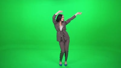 Caucasian Cheerful Female Dancing at a Music Concert Dance and Swing Their Arms on a Green